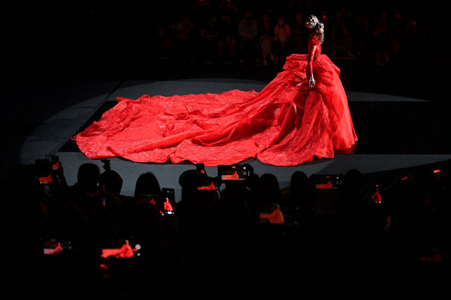 A model displays a creation from William Zhang by Zhang Hongwei during China Fashion Week in Beijing on September 8, 2021. (Photo by Wang Zhao/AFP Photo)