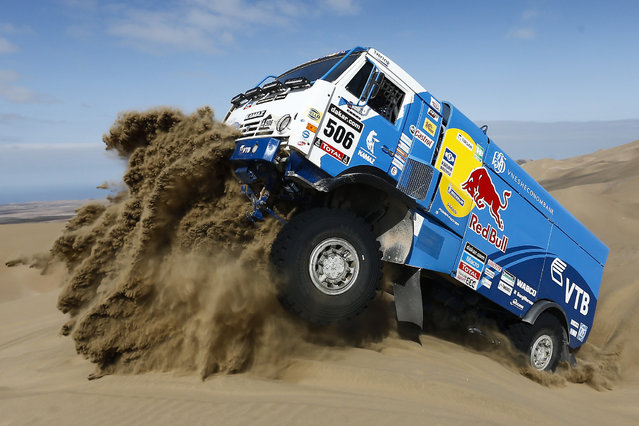 Driver Andrey Karginov and co-pilots Andrey Mokeev and Igor Devyatkin, all from Russia, ride their Kamaz truck up a dune during the tenth stage of the Dakar Rally between the cities of Iquique and Antofagasta, Chile, Wednesday, January 15, 2014. (Photo by Victor R. Caivano/AP Photo)