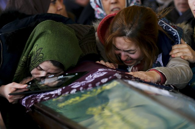 Women cry over the coffin of a car bombing victim during a commemoration ceremony in a mosque in Ankara, Turkey, March 14, 2016. (Photo by Umit Bektas/Reuters)