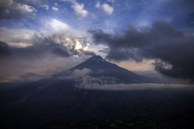 The Tungurahua volcano spewes ashes on February 3, 2014, as seen from Cotalo, south of Quito. A series of explosions rocked Ecuador's Tungurahua volcano, spewing columns of ash into the air that reached as far as Quito. Ash fall from the plumes was reported up to 130 kilometers (80 miles) north in the Ecuadoran capital, authorities said. Located in central Tungurahua province, it came rumbling to life again on Saturday, prompting the evacuation of hundreds of people from nearby villages. (Photo by Daniel Tapia/AFP Photo)