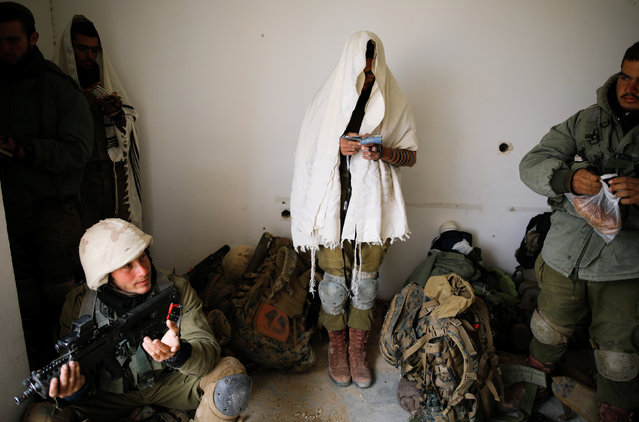 Israeli soldiers from the Nahal Infantry Brigade pray during an urban warfare drill in an abandoned hotel in Arad, southern Israel February 8, 2017. (Photo by Amir Cohen/Reuters)
