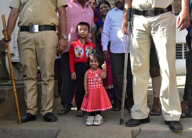 "Jyoti Amge, 25, who holds the Guinness World Records title for the ""Shortest Living Woman"", shows her ink-marked finger after casting her vote at a polling station during the first phase of the general election in Nagpur, India, April 11, 2019. (Photo by Reuters/Stringer)"