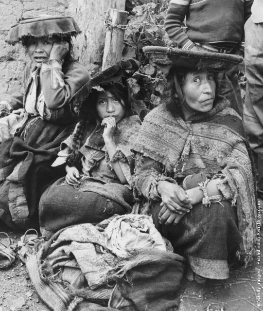 A Quechua woman hides her merchandise of coco leaves, at the market at Pisac, Peru, 1955
