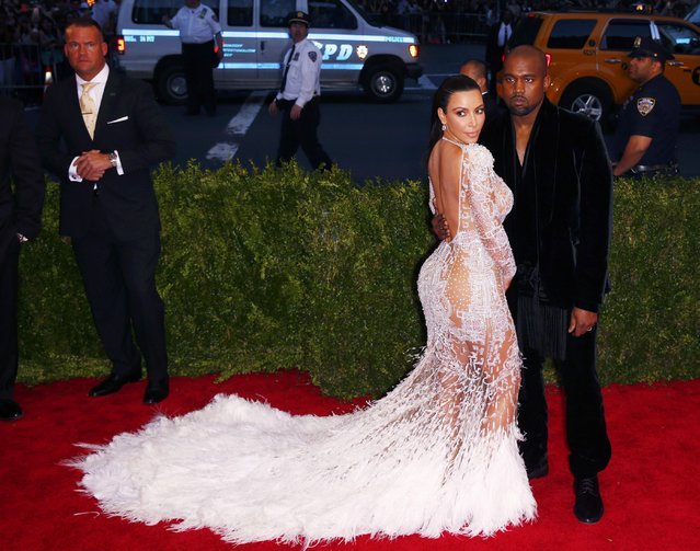 "Kim Kardashian and Kanye West arrive at the Metropolitan Museum of Art Costume Institute Gala 2015 celebrating the opening of ""China: Through the Looking Glass"" in Manhattan, New York May 4, 2015. (Photo by Lucas Jackson/Reuters)"