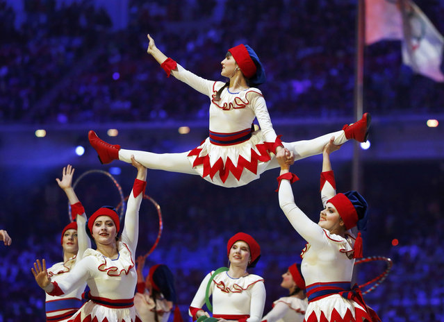 Performers of a circus take part in the closing ceremony for the Sochi 2014 Winter Olympics, February 23, 2014. (Photo by Lucy Nicholson/Reuters)