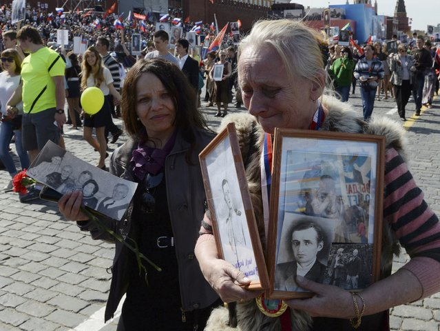 People hold pictures of World War Two soldiers as they take part in the Immortal Regiment march during the Victory Day celebrations at Red Square in Moscow, Russia, May 9, 2015. (Photo by Reuters/Host Photo Agency/RIA Novosti)