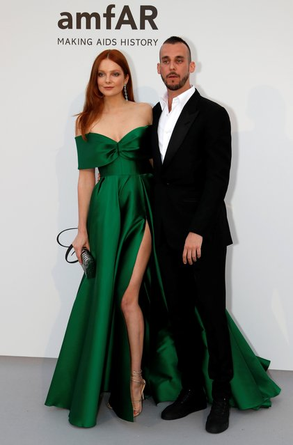 Eniko Mihalik poses with guest for photographers upon arrival at the amfAR, Cinema Against AIDS, benefit at the Hotel du Cap-Eden-Roc, during the 72nd international Cannes film festival, in Cap d'Antibes, southern France, Thursday, May 23, 2019. (Photo by Eric Gaillard/Reuters)