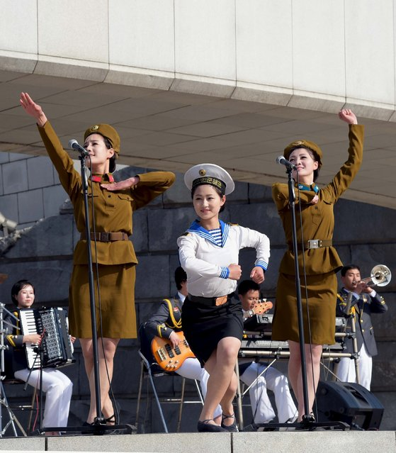 The art squad of the Central Committee of the Kim Il Sung Socialist Youth League gives a performance at the plaza of the Monument to Party Founding on Monday to mark the 4th anniversary of supreme leader Kim Jong Un's assumption of the top posts of the party and state, in this photo released by North Korea's Korean Central News Agency (KCNA) on April 11, 2016. (Photo by Reuters/KCNA)