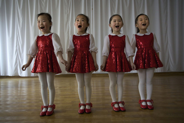 North Korean children perform at the Kaeson Kindergarten in Pyongyang, North Korea, April 27, 2012. For North Koreans, the systematic indoctrination of anti-Americanism starts as early as kindergarten and is as much a part of the curriculum as learning to count. (Photo by Vincent Yu/AP Photo)
