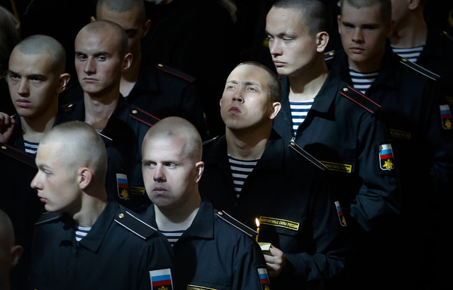 Navy sailors attend a religion service to commemorate the crew members that were killed on one of the Russian navy's deep-sea research submersibles at Kronshtadt Navy Cathedral outside St.Petersburg, Russia, Thursday, July 4, 2019. Some crew members survived a fire that killed 14 sailors on one of the Russian navy's deep-sea submersibles, Russia's defense minister said Wednesday without specifying the number of survivors from the blaze. (Photo by Dmitri Lovetsky/AP Photo)