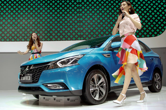 Girls perform next to Luxgen S3 sedan presented at the company's booth during the Auto China 2016 auto show in Beijing, China, April 26, 2016. (Photo by Kim Kyung-Hoon/Reuters)