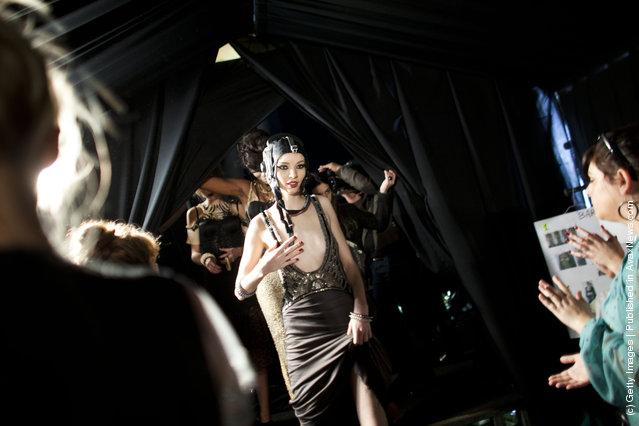 Models prepare backstage before a fashion show by Israeli designer Yossef during the Tel Aviv Fashion Week