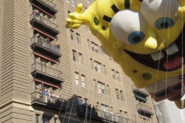 The SpongeBob SquarePants balloon makes it's way through NYC streets during the 85th Annual Macy's Thanksgiving Day Parade