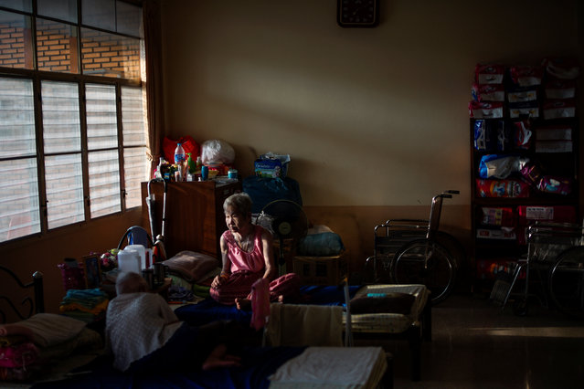 Elderly people are seen at Bangkhae Home Foundation in Bangkok, Thailand, April 27, 2016. Many Thai families look after elderly relatives at a cost that countrywide adds up to just under a third of household income. The number of families facing this issue will balloon as the population ages at a rate among the fastest in Southeast Asia. (Photo by Athit Perawongmetha/Reuters)