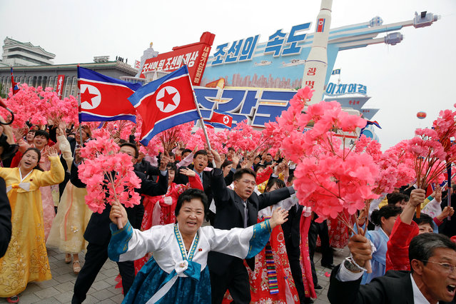People react as they see North Korean leader Kim Jong Un during a mass rally and parade in the capital's main ceremonial square, a day after the ruling party wrapped up its first congress in 36 years by elevating him to party chairman, in Pyongyang, North Korea, May 10, 2016. (Photo by Damir Sagolj/Reuters)