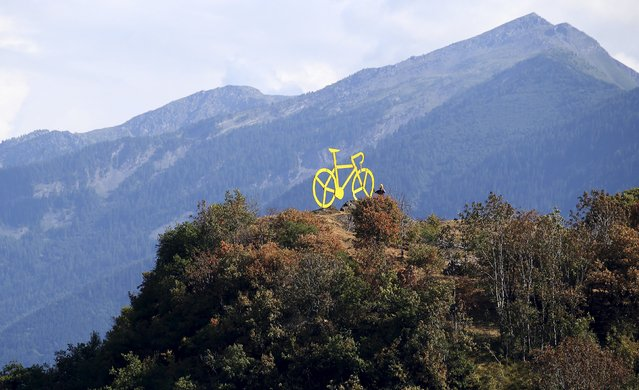 A giant yellow bicycle is seen on a hill during the 18th stage of the 102nd Tour de France cycling race from Gap to Saint-Jean-de-Maurienne in the French Alps July 23, 2015. (Photo by Stefano Rellandini/Reuters)