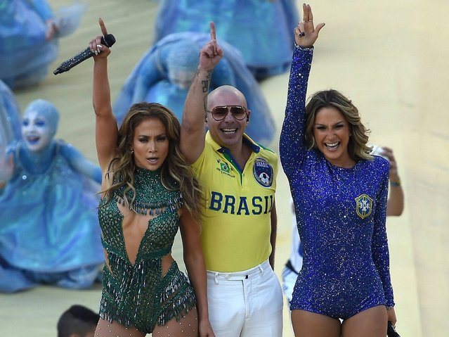 Singers Claudia Leitte, Jennifer Lopez and Pitbull perform during the Opening Ceremony of the 2014 FIFA World Cup Brazil prior to the Group A match between Brazil and Croatia at Arena de Sao Paulo on June 12, 2014 in Sao Paulo, Brazil. (Photo by Kevin C. Cox/Getty Images)