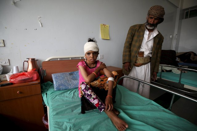 A child injured in a recent Saudi-led air strike sits on a hospital bed in Yemen's capital Sanaa July 25, 2015. Saudi-led coalition forces announced a humanitarian truce in their campaign against Houthi forces in Yemen would take effect on Sunday evening at 11:59 p.m local time, Saudi state news agency SPA said. (Photo by Mohamed al-Sayaghi/Reuters)
