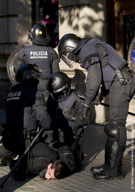 Riot police clash with demonstrators during heavy clashes with demonstrators during a 24-hour strike on March 29, 2012 in Barcelona, Spain