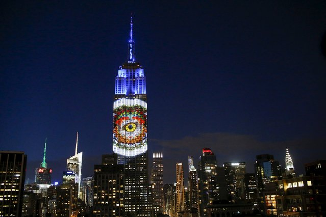 Images are projected onto the Empire State Building as part of an endangered species projection to raise awareness, in New York August 1, 2015. (Photo by Eduardo Munoz/Reuters)