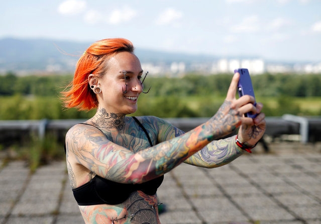 Kaitlin, 28, from the United States takes a selfie as she waits to be suspended by the professional body artist Dino Helvida in Zagreb, Croatia June 7, 2016. (Photo by Antonio Bronic/Reuters)