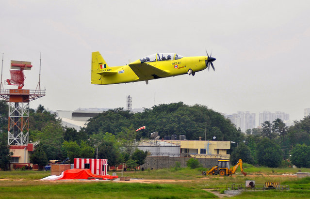 A Hindustan Aeronautics Limited (HAL) designed and developed Hindustan Turbo Trainer-40 (HTT-40) trainer aircraft flies during its inaugural flight at the HAL airport in Bengaluru, India, June 17, 2016. (Photo by Abhishek N. Chinnappa/Reuters)