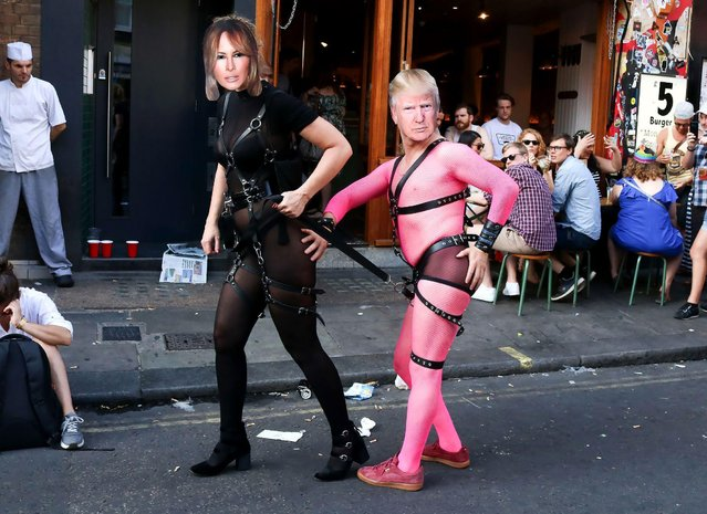 Revellers dressed as Melania Trump and Donald Trump take part in London Pride, the Lesbian, Gay, Bisexual, and Transgender (LGBT) parade in London, Britain, 08 July 2017. (Photo by Amer Ghazzal/Rex Features/Shutterstock)