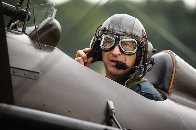 """Shuttleworth Collection Pilot Rodger """"Dodge"""" Bailey prepares for a demonstration flight in a SE5a at """"The Shuttlesworth Collection"""" at Old Warden on July 21, 2014 in Biggleswade, England. Of the 55,000 planes that were manufactured by the Royal Army Corps (RAC) during WWI, only around 20 remain in airworthy condition. (Photo by Dan Kitwood/Getty Images)"""