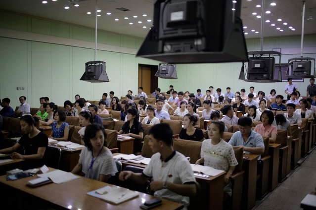 North Korean men and women attend a Chinese language class at the Grand People's Study House on Monday, July 24, 2017, in Pyongyang, North Korea. The building is situated on Kim Il Sung Square and serves as the central library where North Koreans also go to for language classes such as English, Chinese, German and Japanese. (Photo by Wong Maye-E/AP Photo)