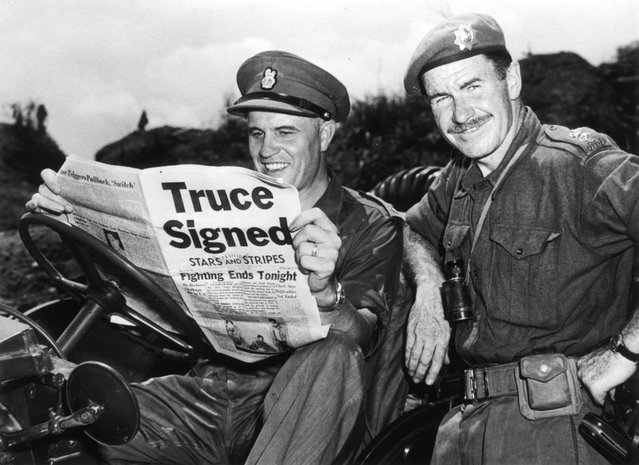 Brigadier Jean Allard, Commanding Officer of the Canadian Brigade breaks the news of a truce in the Korean war to Colonel K L Campbell,  Commander of the 3rd battalion of the RCRS, 2nd August 1953. (Photo by Fox Photos)