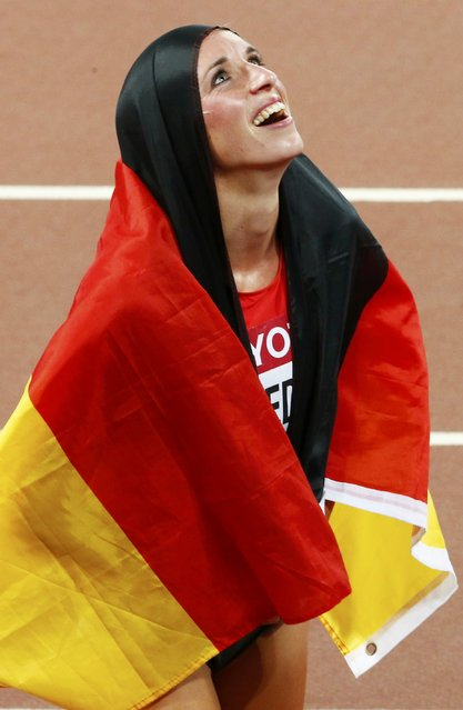Cindy Roleder of Germany celebrates finishing second in the women's 100 metres hurdles final during the 15th IAAF World Championships at the National Stadium in Beijing, China August 28, 2015. (Photo by David Gray/Reuters)