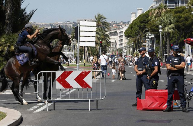 Mounted French municipal police patrol to maintain security after the Bastille Day truck attack by a driver who ran into a crowd on the Promenade des Anglais that killed scores and injured as many, in Nice, France, July 17, 2016. (Photo by Eric Gaillard/Reuters)