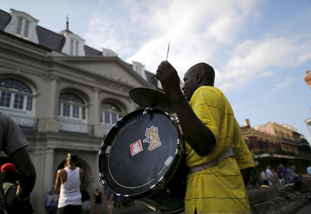 A brass band performs in Jackson Square one day before the ten year anniversary of Hurricane Katrina in New Orleans, Louisiana, August 28, 2015. (Photo by Jonathan Bachman/Reuters)