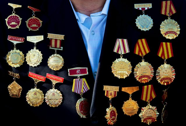 An honour guest with medals on his coat arrives to his seat to watch a military parade commemorating the 70th anniversary of the end of World War Two in Beijing, China September 3, 2015. (Photo by Andy Wong/Reuters)
