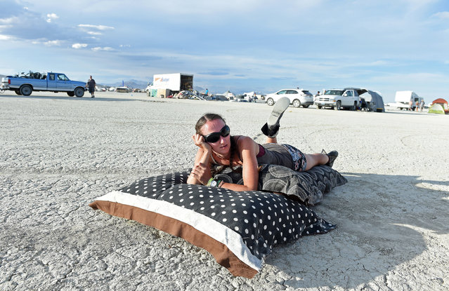 Jamie Sparks relaxes after arriving on the playa at Burning Man on Friday, August 28, 2015, in the Black Rock Desert near Gerlach, Nev. Once a year, participants gather for Burning Man in Nevada's Black Rock Desert to create Black Rock City, dedicated to community, art, self-expression and self-reliance. (Photo by Andy Barron/The Reno Gazette-Journal via AP Photo)