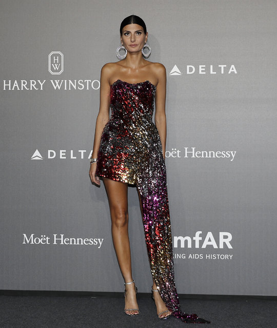 Giovanna Battaglia poses for photographers as she arrives for the amfAR charity dinner during the fashion week in Milan, Italy, Thursday, September 21, 2017. (Photo by Antonio Calanni/AP Photo)