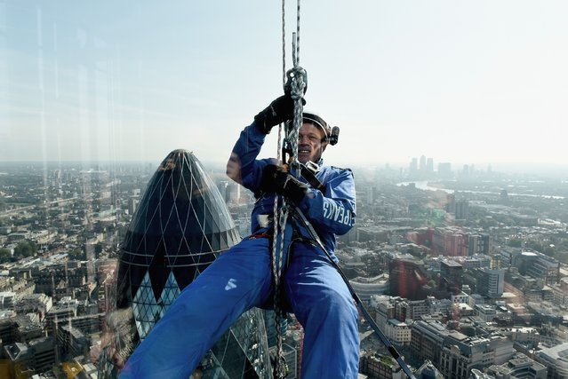 """Matt Pullen from AzkoNobel abseils down the skyscraper known as the """"Cheesegrater"""" at 122 Leadenhall Street, during the Outward Bound Trust's and the RoyaL Navy and Royal Marines Charity's most daring stunt: The City Three Peaks Challenge, on September 7, 2015 in London, England. (Photo by Mary Turner/Getty Images for the Outward Bound Trust and the Royal Navy and Royal Marines Charity)"""