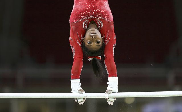 2016 Rio Olympics, Gymnastics training, Rio Olympic Arena, Rio de Janeiro, Brazil on August 4, 2016. Simone Biles (USA) of USA trains on the uneven bars. (Photo by Damir Sagolj/Reuters)
