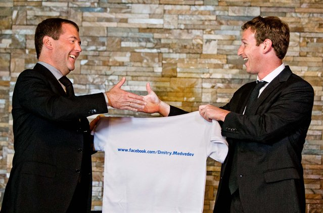 Russian Prime Minister Dmitry Medvedev shakes hands with Facebook CEO Mark Zuckerberg at the Gorki residence outside Moscow,  Russia, on Oktober 1, 2012. Zuckerberg presented Medvedev with a T-shirt bearing his Facebook address. (Photo by Alexander Zemlianichenko/Associated Press)