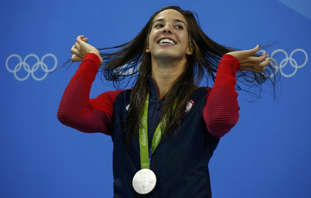 2016 Rio Olympics, Swimming, Victory Ceremony, Women's 400m Individual Medley Victory Ceremony, Olympic Aquatics Stadium, Rio de Janeiro, Brazil on August 6, 2016. Maya DiRado (USA) of USA celebrates on the podium with her silver medal. (Photo by David Gray/Reuters)