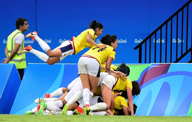 Catalina Usme #11 of Colombia celebrates her goal with teammates in the second half against the United States in the Women's Football First Round Group G match on Day 4 of the Rio 2016 Olympic Games at Amazonia Arena on August 9, 2016 in Rio de Janeiro, Brazil. (Photo by Bruno Zanardo/Getty Images)