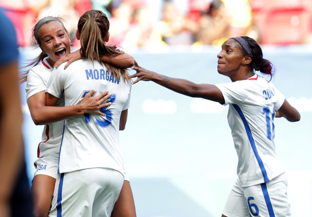 United States' Alex Morgan, center left, celebrates with teammates Mallory Pugh, left, Crystal Dunn after scoring during a quarter-final match of the women's Olympic football tournament between the United States and Sweden in Brasilia Friday August 12, 2016. (Photo by Eraldo Peres/AP Photo)