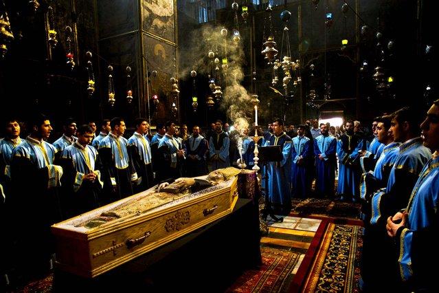 Armenian clergy attend the funeral of the Armenian Patriarch of Jerusalem Torkom Manougian, in the Old City of Jerusalem October 22, 2012. Manougian was 93. (Photo by Bernat Armangue/Associated Press)