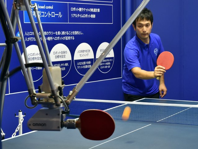 Japan's electronics maker Omron displays the pingpong robot, which returns the ball to a spot facilitating return by the opponent player at the CEATEC electronics trade show in Chiba, suburban Tokyo on October 7, 2014. (Photo by Yoshikazu Tsuno/AFP Photo)