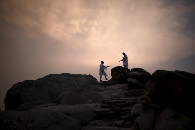 Muslim pilgrims visit Mount Thor in the holy city of Mecca ahead of the annual haj pilgrimage September 19, 2015. Mount Thor marks the start of the journey of the Prophet Mohammad and his companion Abu Bakr Al-Sadeeq from Mecca to Medina. It houses Thor cave where Prophet Mohammed is believed to have hid from the people of Quraish before his Hijra (migration) to Medina. (Photo by Ahmad Masood/Reuters)