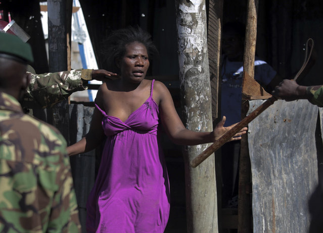 A woman is chased away as police try to stop the opposition from holding demonstrations in Nairobi, Kenya, Tuesday, November 28, 2017. (Photo by Brian Inganga/AP Photo)