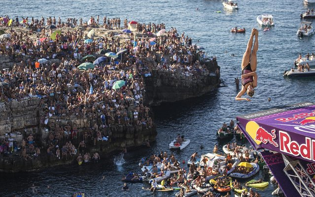 Lysanne Richard of Canada dives from the 21.5 metre platform during the fifth stop of the Red Bull Cliff Diving World Series in Polignano a Mare, Italy on August 28 2016. (Photo by Dean Treml/ANSA/Red Bull Press Office)
