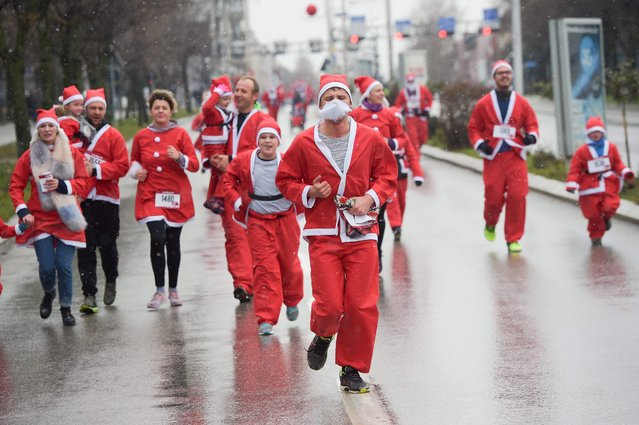 Runners dressed as Santa Claus take part in a charity race in Pristina, on December 17, 2017, to raise funds for families in need in Kosovo. (Photo by Armend Nimani/AFP Photo)