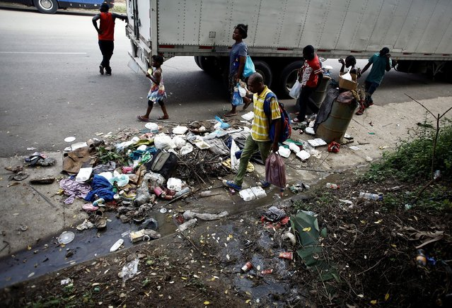 Africans migrants stranded in Costa Rica walk near garbage on the Inter-American highway at the border between Costa Rica and Nicaragua, in Penas Blancas, Costa Rica, September 8, 2016. (Photo by Juan Carlos Ulate/Reuters)