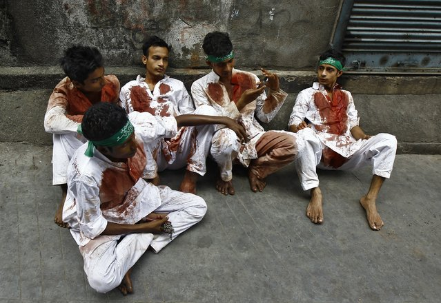 Shi'ite Muslims rest after flagellating themselves in a Muharram procession to mark Ashoura in Kolkata November 4, 2014. (Photo by Rupak De Chowdhuri/Reuters)